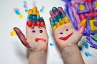 Little Children Hands doing Fingerpainting